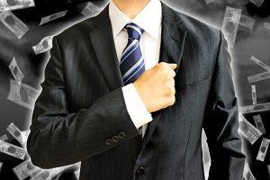 暗い背景とビジネスマン