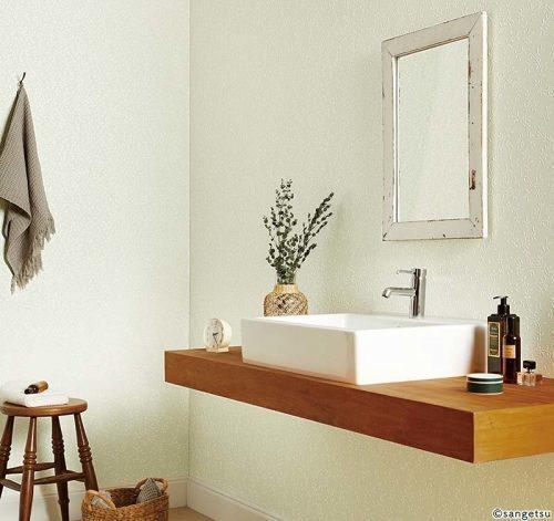 ライトグリーンで清涼感のある洗面所